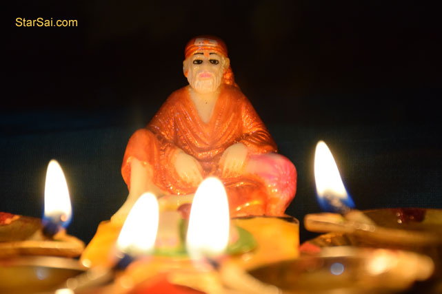 Sai Baba with lamps