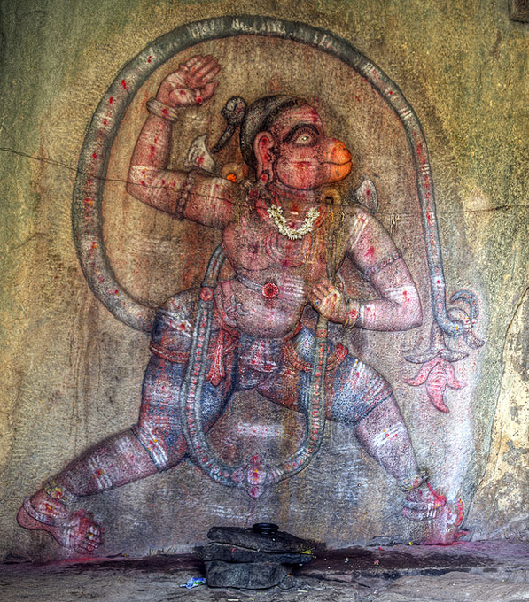 Lord Hanuman in a Hanuman temple , Humpi Hanuman carvings on rock