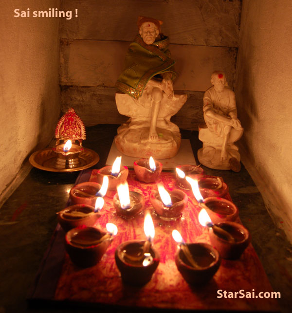 Two Shirdi Saibaba statues in our small mandhir accepting light n love